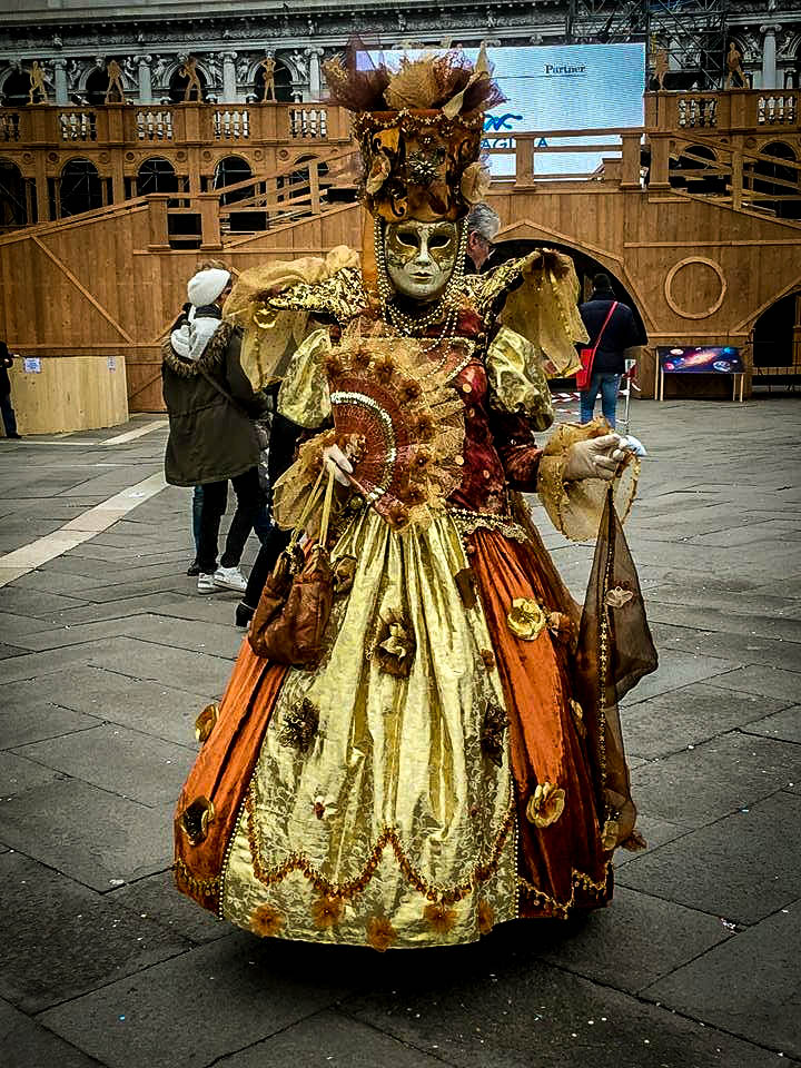 Woman wearing a dress at the Carnival of Venice