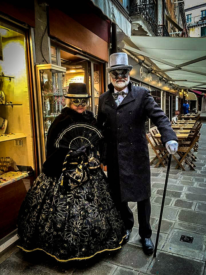 Couple wearing black clothes at the Carnival of Venice