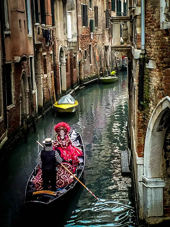 Woman riding a gondola at the Carnival of Venice