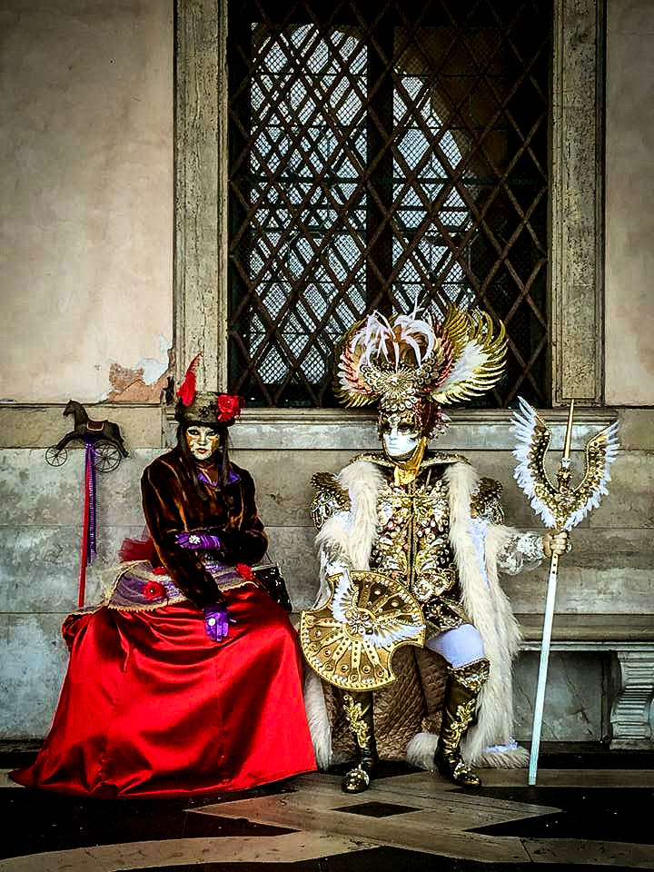 People sitting and waiting at the Carnival of Venice