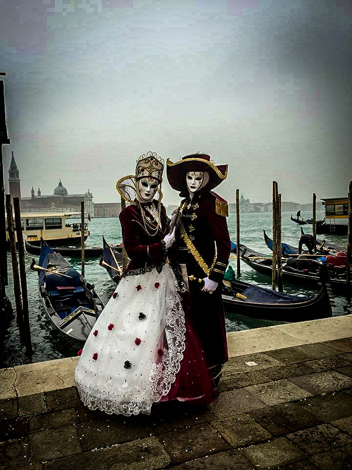 Couple posing at Venice Port during Carnival