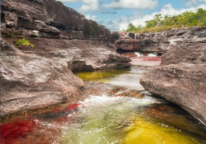 "The river is commonly called the ""River of Five Colors"" or the ""Liquid Rainbow,"" and is noted for its striking colors."
