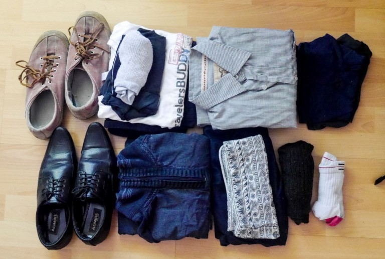2 pairs of shoes, 4 tshirts, 1 shirt, 1 pair of shorts, 1 pair of pants, a tank top, 3 pair of socks, 3 pairs of underwear and one jacket
