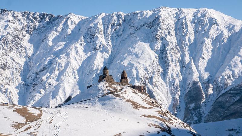Road trip in Georgia Gergeti Trinity Church on Winter