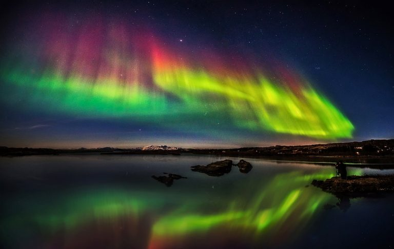 Take long exposure photograph with a tripod. Results of the northern lights will be way better