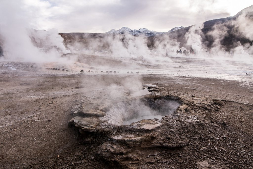 View of several fumaroles and geysers in El Tatio after sunrise