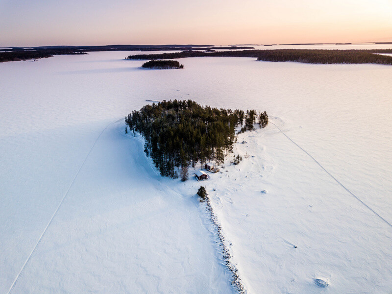 Ice cover the islands during a snowmobile tour