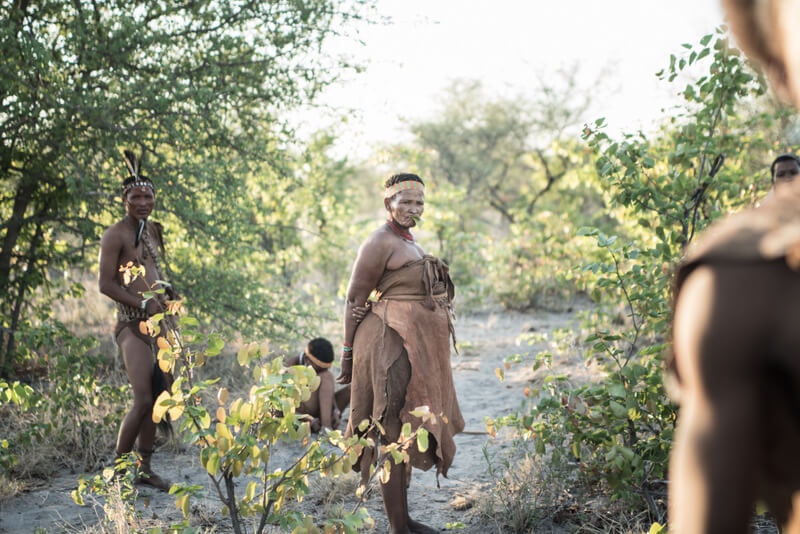 A female San member of the community in the African savanna