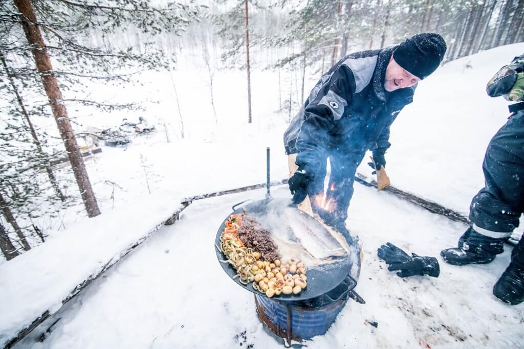 Outdoor cooking and ice fishing is very popular during a safari adventure tour