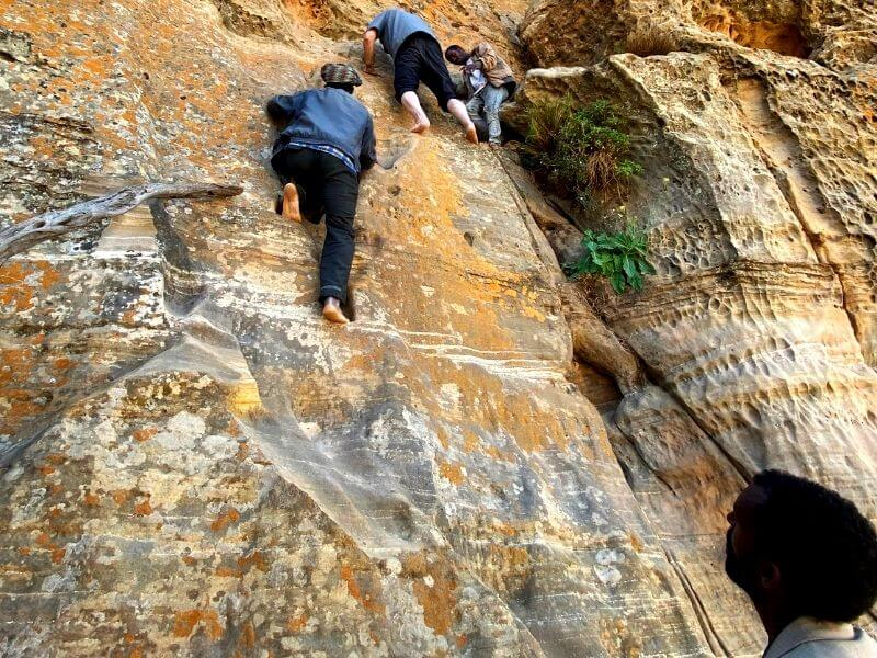 Locals and foreigners climbing up to reach Abuna Yemata Guh in Ethiopia