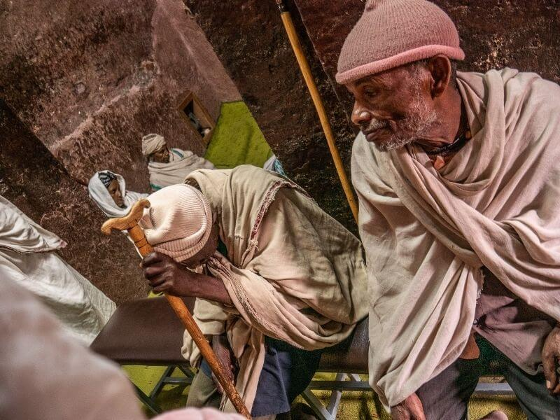 Pilgrims inside one of the rock-hewn churches of Lalibela