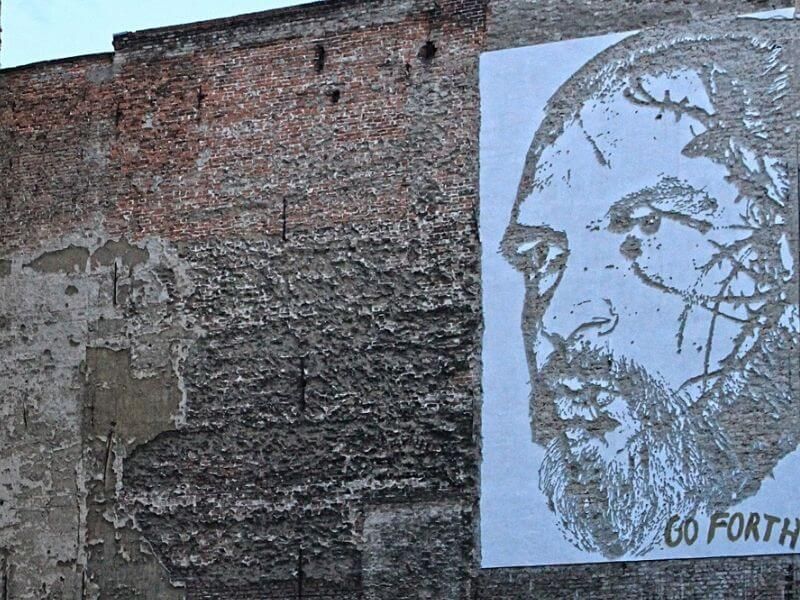 Artist Vhils is known for his  jackhammered murals in Berlin